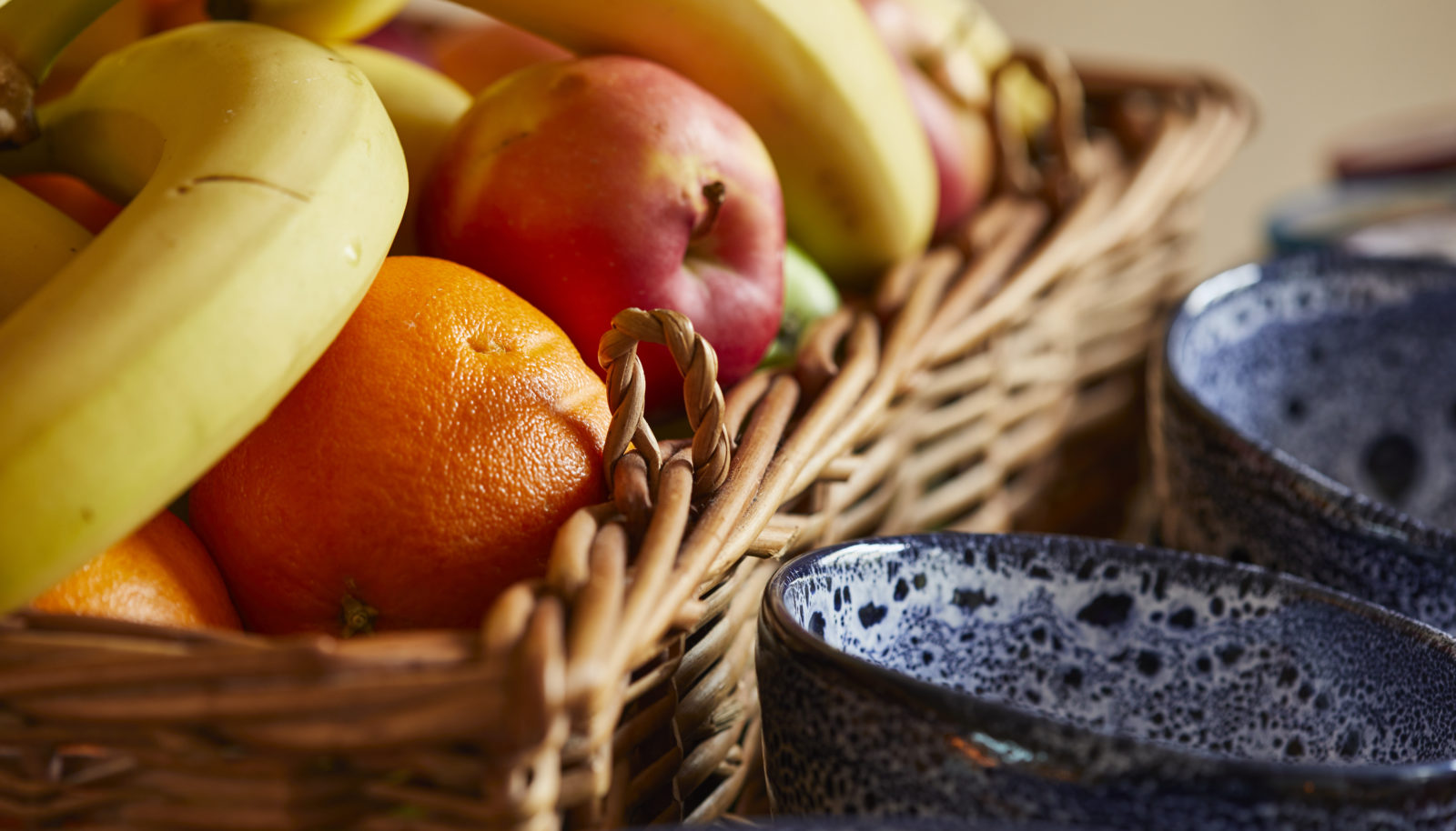 fresh fruit in basket and blue bowls